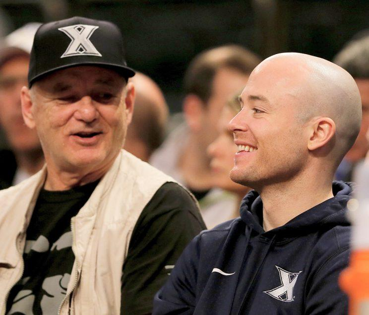 Coach Luke Murray watches the game between the Creighton Bluejays and the Seton Hall Pirates with his father, actor Bill Murray