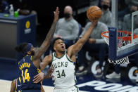 Milwaukee Bucks' Giannis Antetokounmpo (34) dunks against Indiana Pacers' JaKarr Sampson (14) during the second half of an NBA basketball game Thursday, May 13, 2021, in Indianapolis. (AP Photo/Darron Cummings)