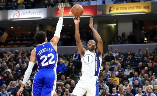 Indiana's T.J. Warren (R) takes a shot in the Pacers' NBA victory over the Philadelphia 76ers