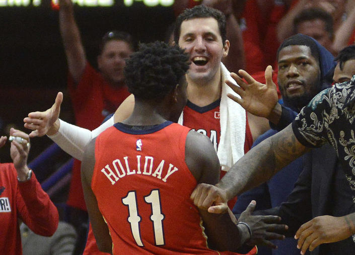 Jrue Holiday promised New Orleans Pelicans teammate Nikola Mirotic a bottle of wine for every 30-point game this year. (AP)