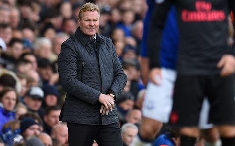 Everton's Dutch manager Ronald Koeman (L) watches from the touchline during the English Premier League football match - Credit: AFP/Getty Images