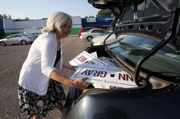 PHOTO: Jenn Gray loads campaign signs for her candidacy for the Alabama state legislature. (Meg McKinney)