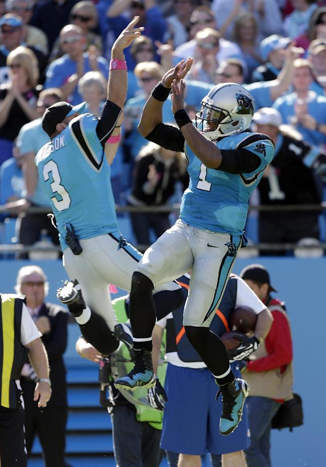 Carolina Panthers' Cam Newton, right, and Derek Anderson (3) celebrate a Panthers touchdown against the St. Louis Rams in the second half of an NFL football game in Charlotte, N.C., Sunday, Oct. 20, 2013. The Panthers won 30-15. (AP Photo/Bob Leverone)