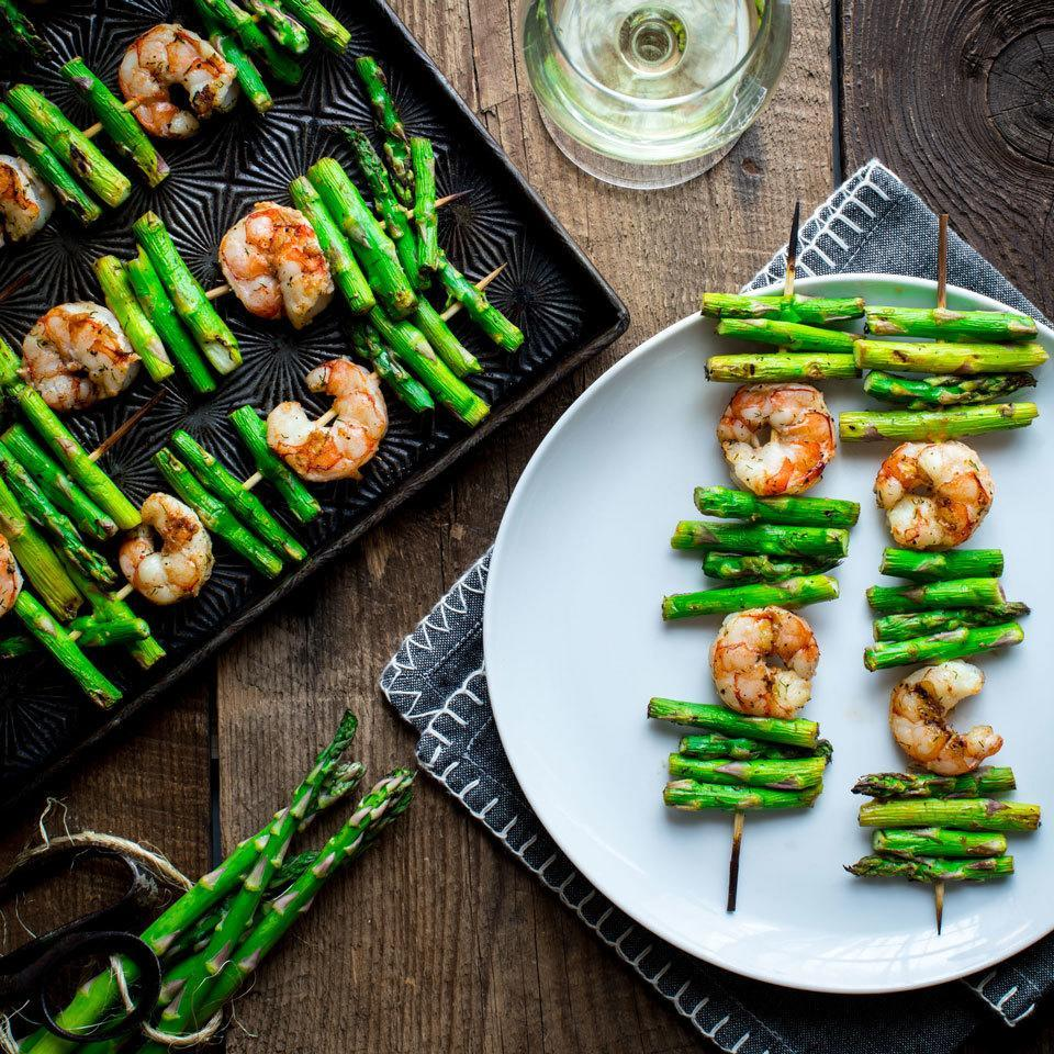 """<p>Shrimp and asparagus both cook very quickly, making them a perfect pair on the grill. We've seasoned them in delicate flavors--lemon, garlic and dill--so their natural sweetness can shine through. Pick fat asparagus stalks for easier skewering. <a href=""""http://www.eatingwell.com/recipe/264140/garlic-shrimp-asparagus-kebabs/"""" rel=""""nofollow noopener"""" target=""""_blank"""" data-ylk=""""slk:View recipe"""" class=""""link rapid-noclick-resp""""> View recipe </a></p>"""