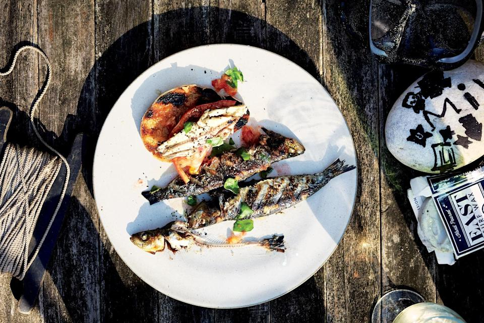 "Even if assertive fish like sardines aren't typically your thing, the mellowed flavor that they take on when grilled—not to mention that crisp skin—might change your mind. What's more, the skin's high oil content means these fish are way less prone to sticking. <a href=""https://www.bonappetit.com/recipe/sardines-grilled-bread-tomato?mbid=synd_yahoo_rss"" rel=""nofollow noopener"" target=""_blank"" data-ylk=""slk:See recipe."" class=""link rapid-noclick-resp"">See recipe.</a>"