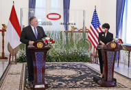 In this photo released by Indonesian Ministry of Foreign Affairs, U.S. Secretary of State Mike Pompeo, left, talks to Indonesian Foreign Minister Retno Marsudi during a joint press conference which was broadcasted online in Jakarta, Indonesia, Thursday, Oct. 29, 2020. Pompeo renewed the Trump administration's rhetorical onslaught against China in Indonesia on Thursday as the American presidential election looms. (Indonesian Ministry of Foreign Affairs via AP)