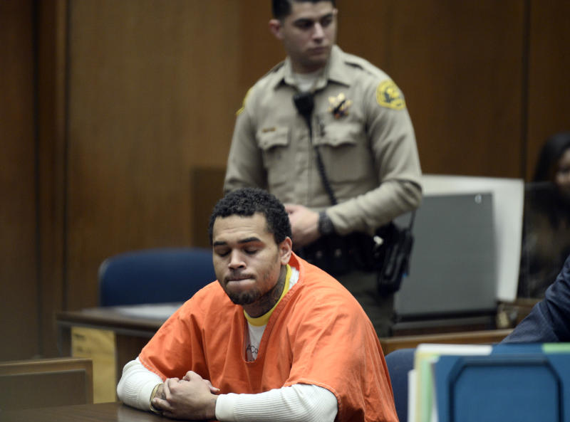 Chris Brown, appears in court Friday May 9, 2014 in Los Angeles. Brown on Friday admitted a probation violation over an altercation last year outside a hotel in Washington, D.C., and was sentenced to remain on probation and serve an additional 131 days in jail. (AP Photo/Paul Buck, POOL)
