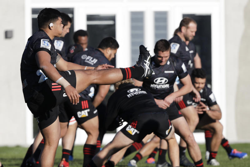 Crusaders players practice during a training session at Rugby Park in Christchurch, New Zealand, Wednesday, May 27, 2020. New Zealand's Super Rugby Aotearoa will start on June 13 in a new five-team, 10-week competition. (AP Photo/Mark Baker)