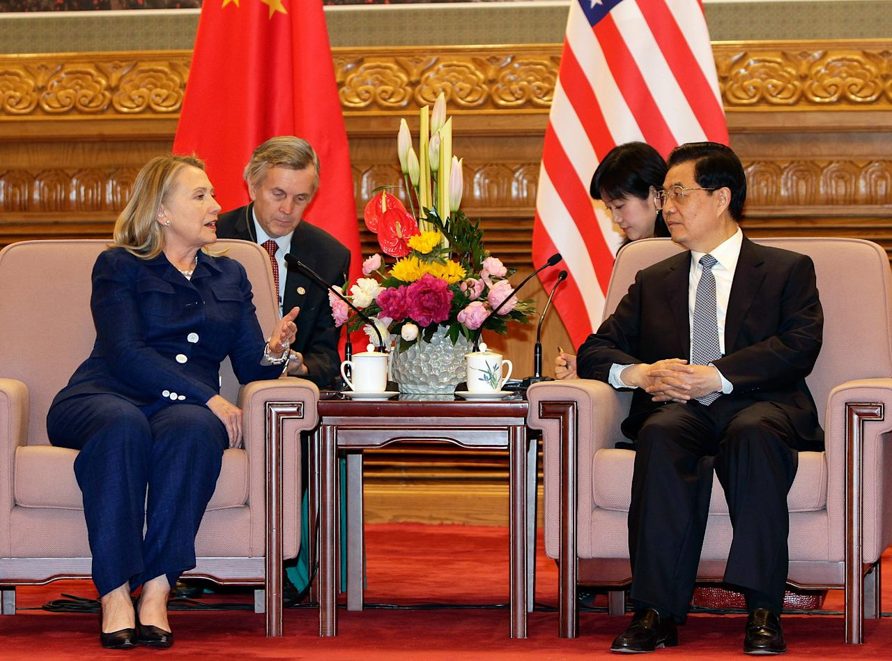 BEIJING, CHINA - MAY 4: U.S. Secretary of State Hillary Clinton (L) talks to China's President Hu Jintao (R) during a meeting at the Great Hall of the People on May 4, 2012 in Bejing, China. Gary Locke, Secretary Clinton, Treasury Secretary Timothy F. Geithner attended a fourth joint meeting of the U.S.-China Strategic and Economic Dialogue with Chinese officials. (Photo by Jason Lee-Pool/Getty Images)