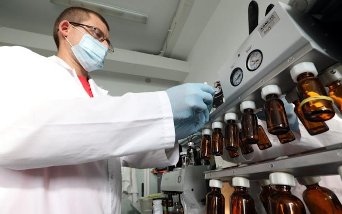 Junior researcher Ilya Novikov at a DNA syntesiser in the lab of the Biochemistry Department at the Vernadsky Crimean Federal University - Alexei Pavlishak\\TASS via Getty Images