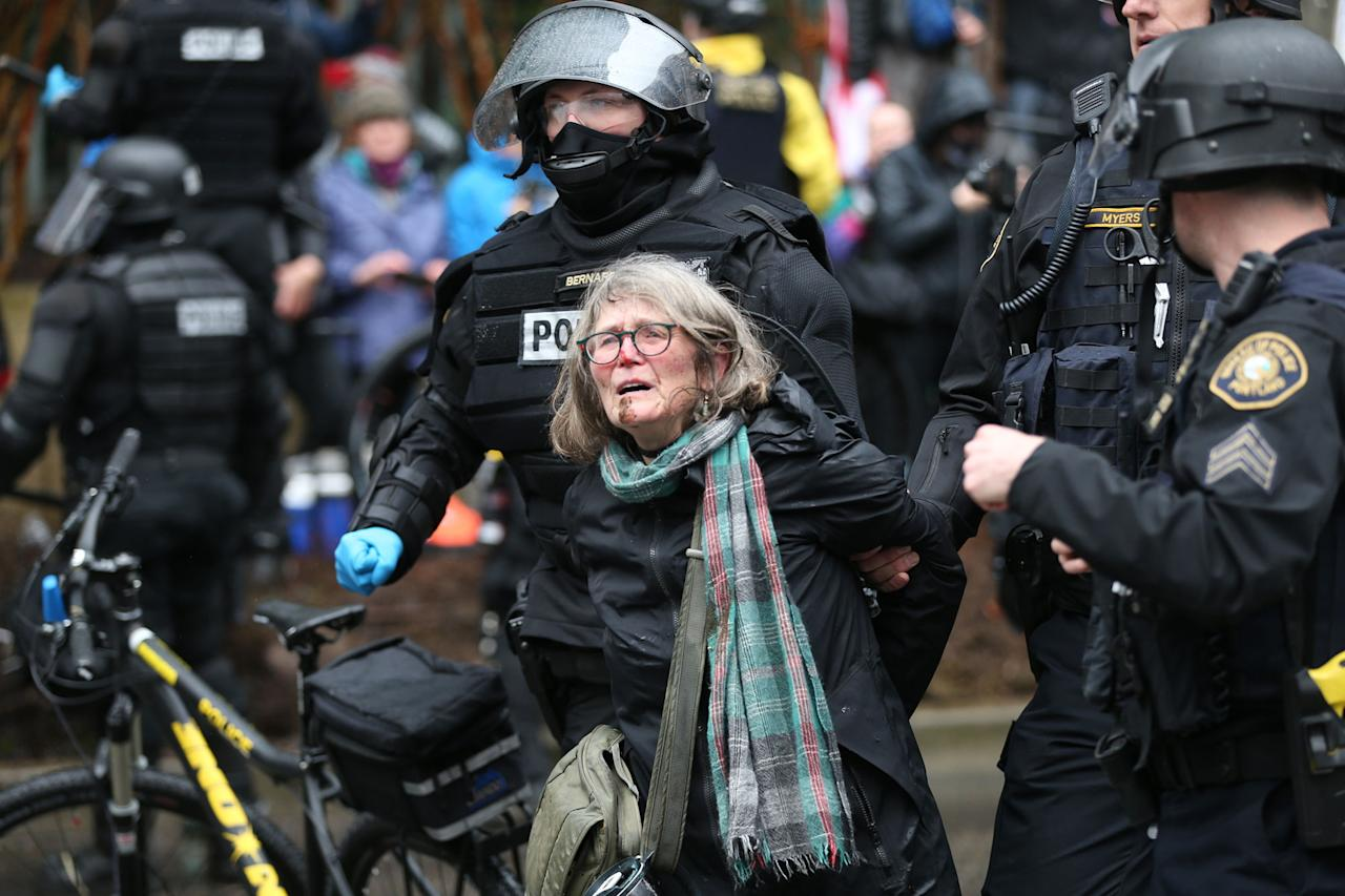<p>A woman is detained during a protest Monday, Feb. 20, 2017, in Portland, Ore. Thousands of demonstrators turned out Monday across the U.S. to challenge President Donald Trump in a Presidents Day protest dubbed Not My President's Day. (Dave Killen/The Oregonian via AP) </p>