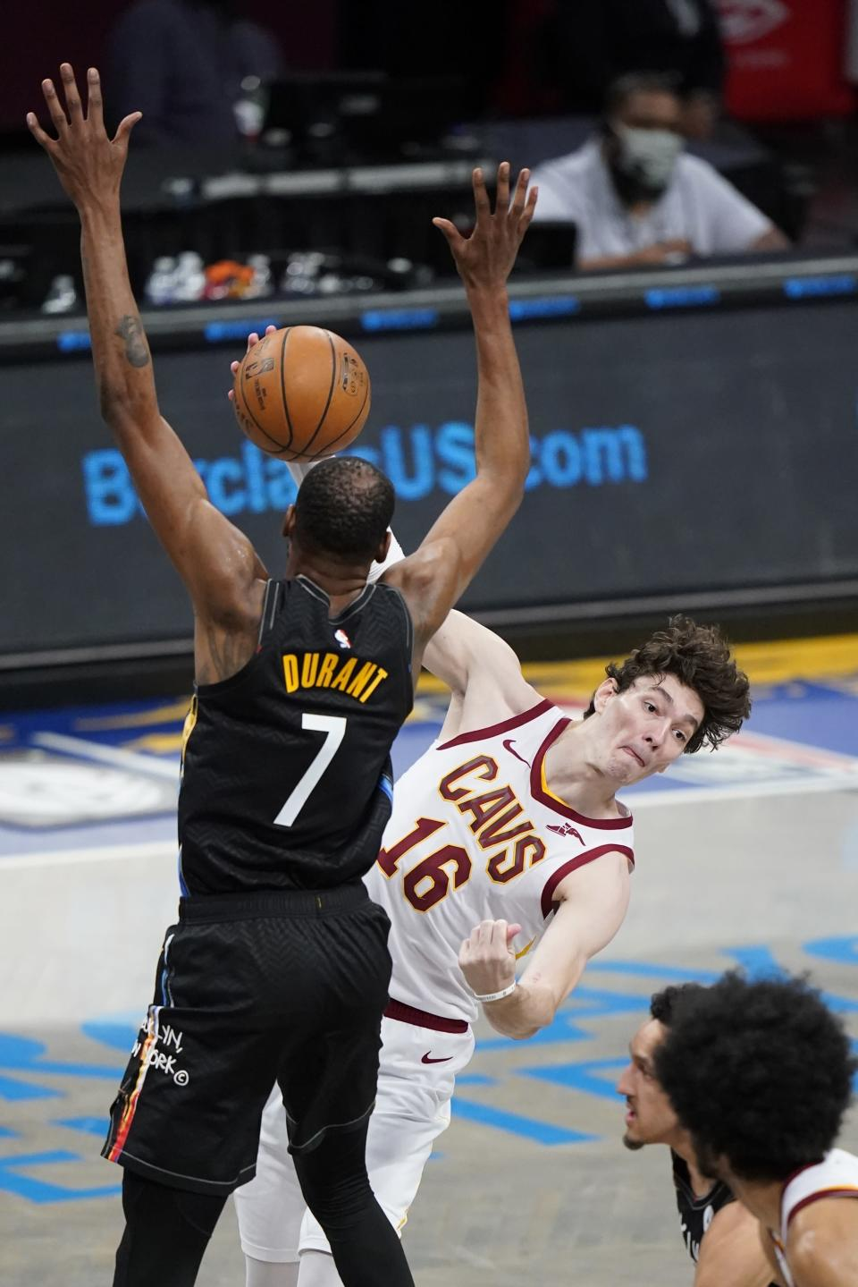 Cleveland Cavaliers' Cedi Osman (16) passes away from Brooklyn Nets' Kevin Durant (7) during the second half of an NBA basketball game Sunday, May 16, 2021, in New York. (AP Photo/Frank Franklin II)