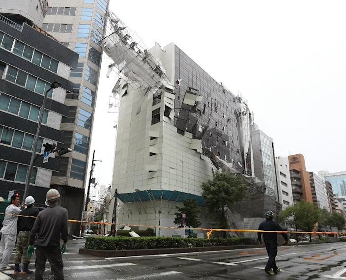 Scaffolding is torn off a building in Osaka raked by the high winds (AFP Photo/JIJI PRESS)