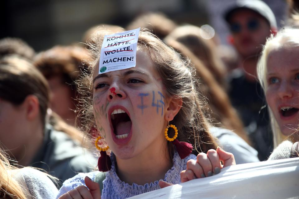 """People take part in the Global Climate Strike of the movement Fridays for Future, in Munich, Germany, September 20, 2019. The slogan on the sticker reads: """"could have, would have, wanted, do it!"""". (Photo: Michael Dalder/Reuters)"""