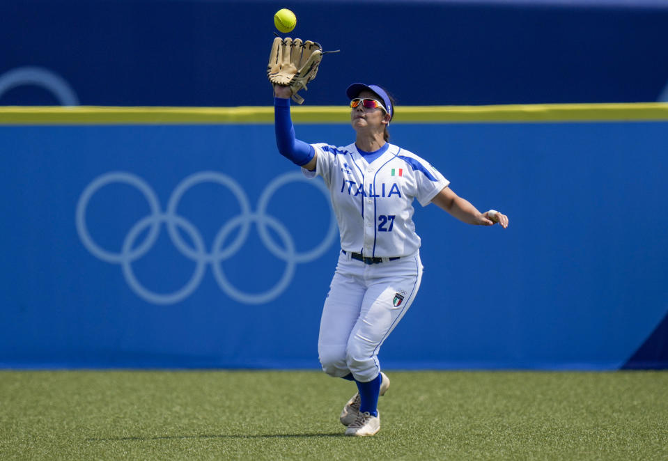 Italy's Giulia Koutsoyanopulos takes a catch during the softball game between Italy and the United States at the 2020 Summer Olympics, Wednesday, July 21, 2021, in Fukushima, Japan. (AP Photo/Jae C. Hong)