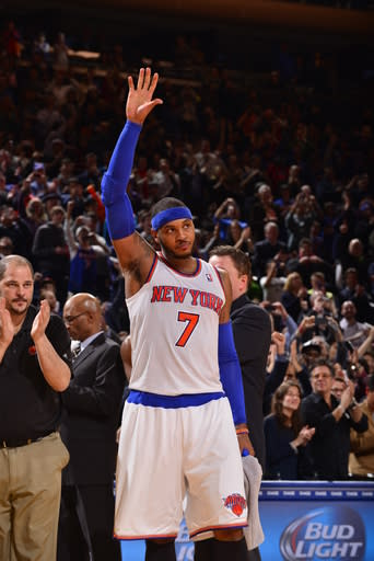 NEW YORK - JANUARY 24: Carmelo Anthony #7 of the New York Knicks waves to the crowd after the game against the Charlotte Bobcats on January 24, 2014 at Madison Square Garden in New York City. (Photo by David Dow NBAE via Getty Images)