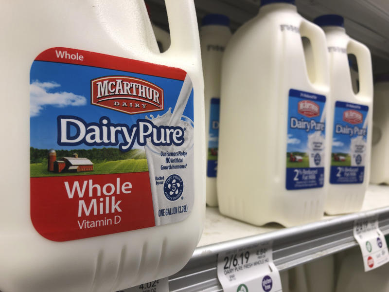 Jugs of McArthur Dairy milk, a Dean Foods brand, are shown at a grocery store, Tuesday, Nov. 12, 2019, in Surfside, Fla. Dean Foods, America's biggest milk processor, filed for bankruptcy Tuesday amid a steep, decades-long drop-off in U.S. milk consumption blamed on soda, juices and, more recently, nondairy substitutes. (AP Photo/Wilfredo Lee)