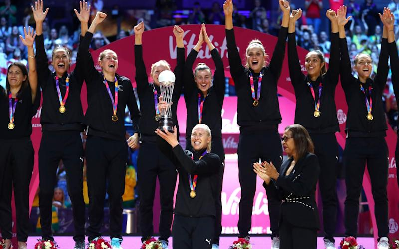 The New Zealand team captain Laura Langman lifts The World Cup Trophy - Getty Images Europe