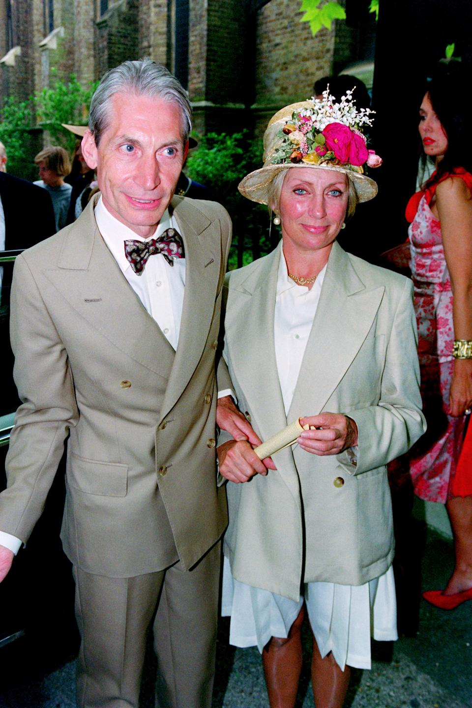 Drummer of The Rolling Stones, Charlie Watts and his wife Shirley Ann Shepherd, attend Georgia May Jagger's christening at Saint Andrew's church, Richmond in 1992. (Photo by Dave Hogan/Hulton Archive/Getty Images)