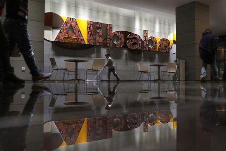 The logo of Alibaba Group is seen inside the company's headquarters in Hangzhou