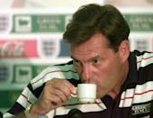 England manager Glenn Hoddle drinks a cup of coffee during a news conference at the training ground in La Boules near Nantes, France. The England team play Romania in their second World cup match in Toulouse next Monday. Photo by Adam Butler/PA