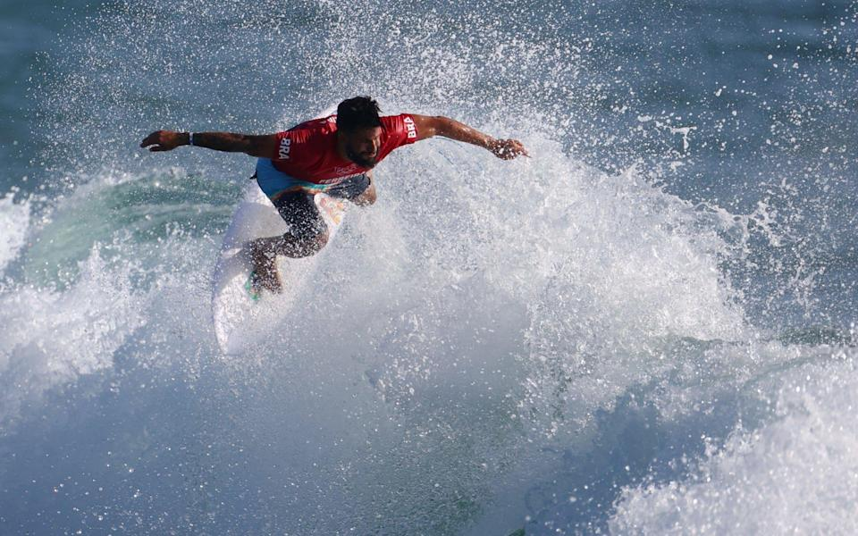 Ítalo Ferreira on his way to winning the first heat - REUTERS
