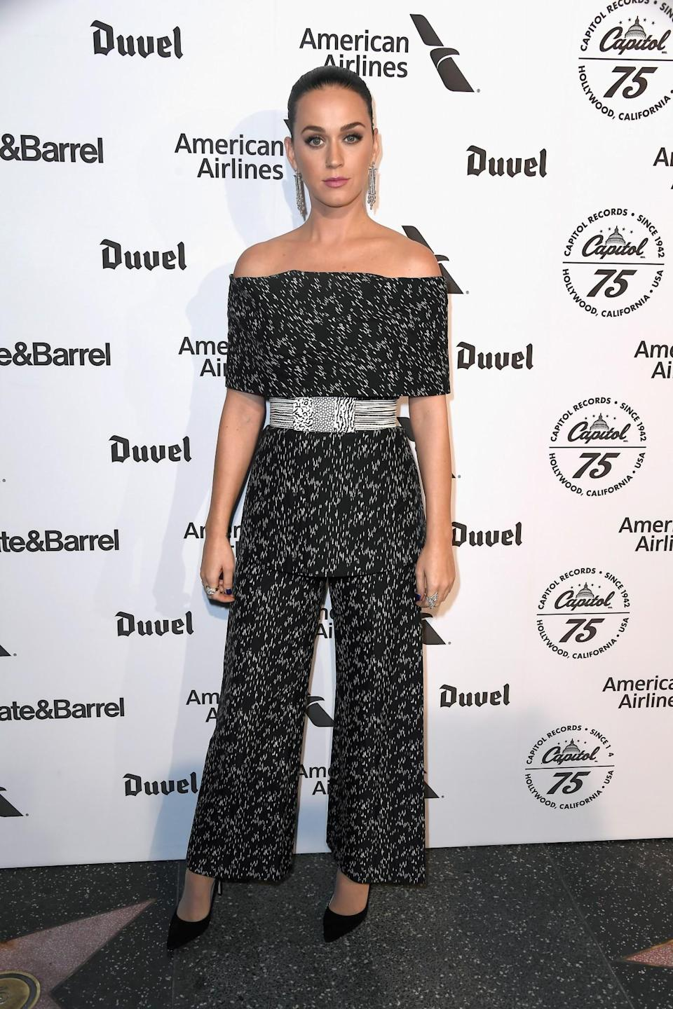 <p>Katy's printed off-the-shoulder jumpsuit and monochrome belt were a little drab with her slicked back do adding little to the look. <i>[Photo: Getty]</i> </p>