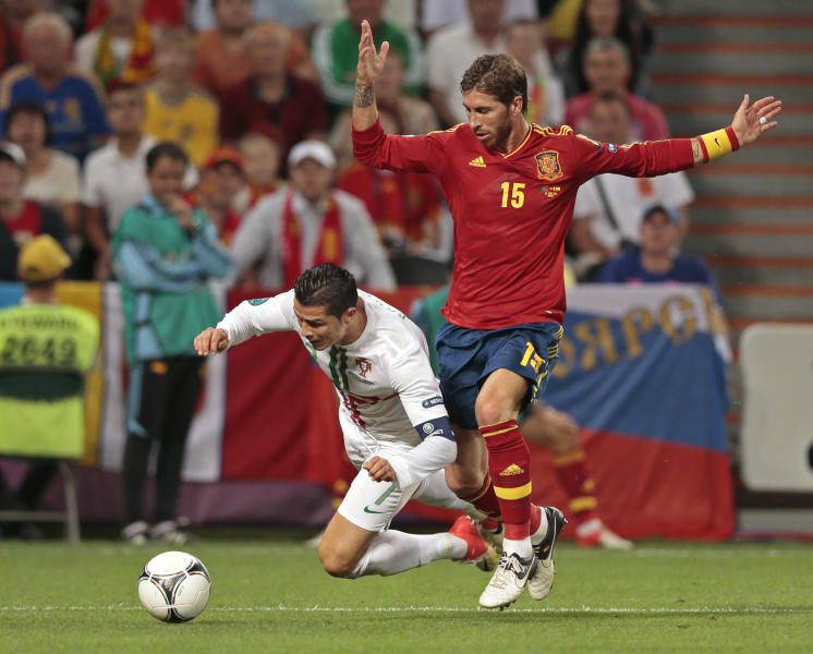 Portugal's Cristiano Ronaldo, left, and Spain's Sergio Ramos duel for the ball during the Euro 2012 soccer championship semifinal match between Spain and Portugal in Donetsk, Ukraine, Wednesday, June 27, 2012. (AP Photo/Ivan Sekretarev)