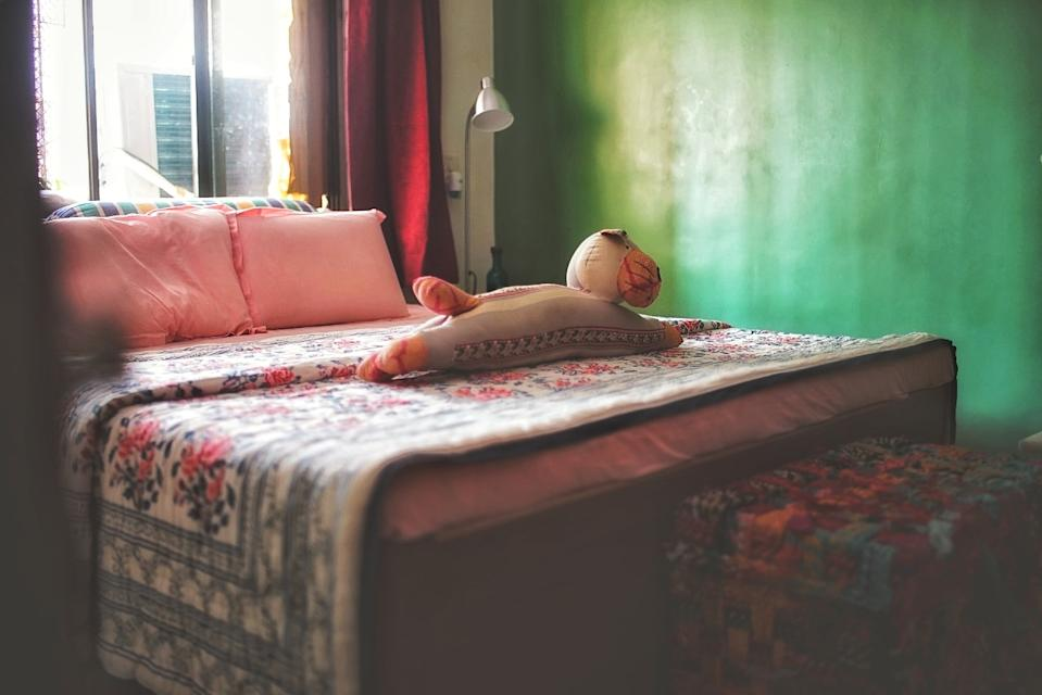 The bedroom is calming in shades of green and pink with plenty of natural light to boot.
