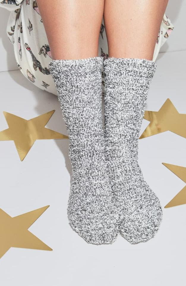 "<p>Honestly, who wouldn't want these bestselling <a href=""https://www.popsugar.com/buy/Barefoot-Dreams-CozyChic-Socks-513082?p_name=Barefoot%20Dreams%20CozyChic%20Socks&retailer=shop.nordstrom.com&pid=513082&price=15&evar1=fab%3Aus&evar9=20750457&evar98=https%3A%2F%2Fwww.popsugar.com%2Ffashion%2Fphoto-gallery%2F20750457%2Fimage%2F46863728%2FBarefoot-Dreams-CozyChic-Socks&list1=shopping%2Choliday%2Cstocking%20stuffers%2Cgift%20guide%2Cgifts%20under%20%2425%2Cwhite%20elephant%20gifts%2Choliday%20fashion%2Cfashion%20gifts%2Cgifts%20for%20women%2Cgifts%20under%20%24100%2Cgifts%20under%20%2450%2Cgifts%20under%20%2475&prop13=mobile&pdata=1"" rel=""nofollow"" data-shoppable-link=""1"" target=""_blank"" class=""ga-track"" data-ga-category=""Related"" data-ga-label=""https://shop.nordstrom.com/s/barefoot-dreams-cozychic-socks/4533308/full?origin=keywordsearch-personalizedsort&amp;breadcrumb=Home%2FAll%20Results&amp;color=heather%20dusk%2F%20white"" data-ga-action=""In-Line Links"">Barefoot Dreams CozyChic Socks</a> ($15)?</p>"