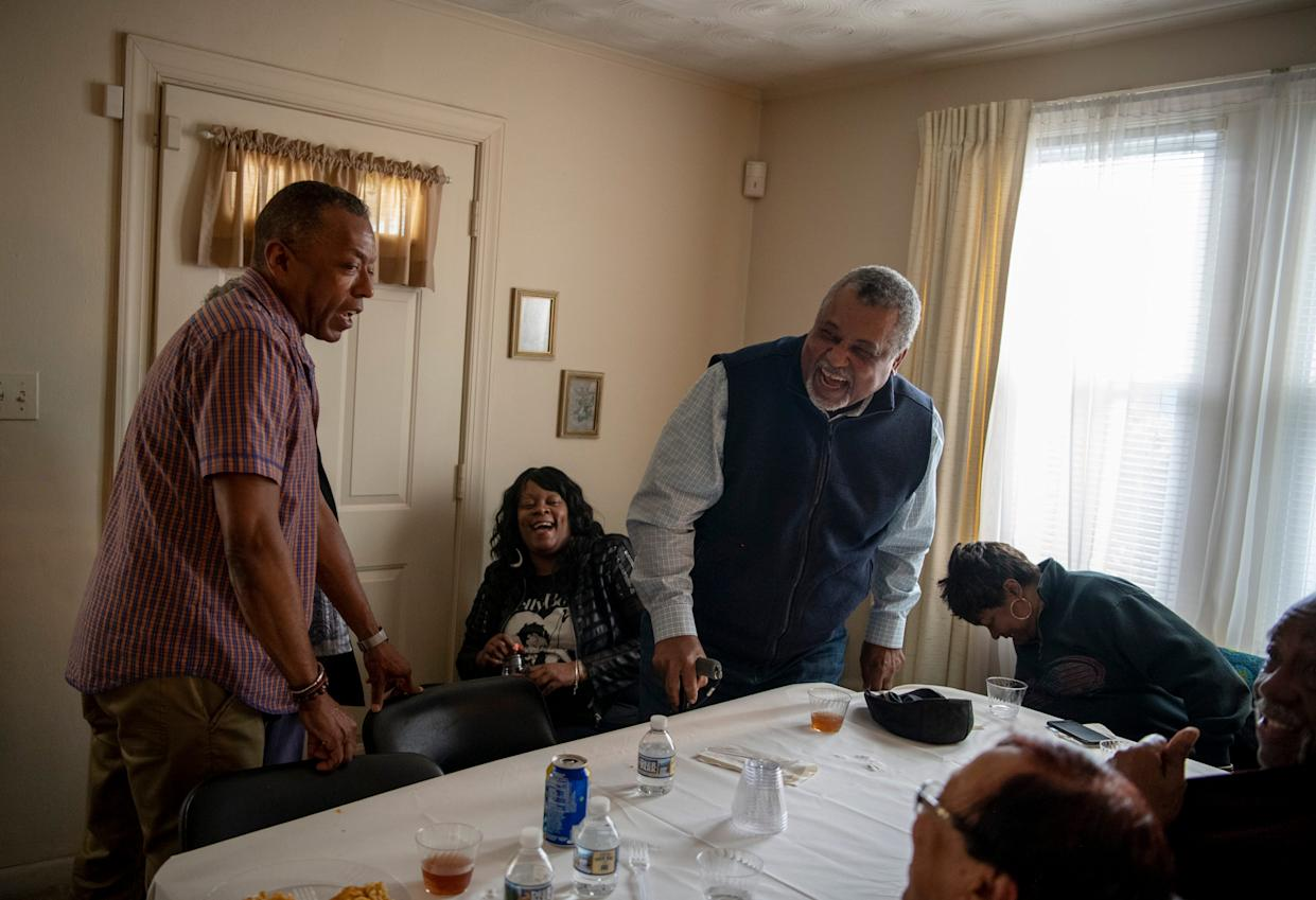Chris Diggs jokes with William F. Tucker during a family birthday party in Hampton, Virginia.