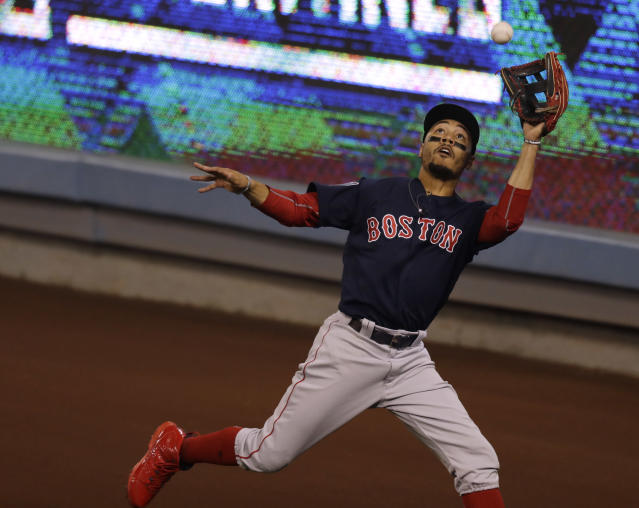 Boston Red Sox's Mookie Betts catches a fly ball by Los Angeles Dodgers' Chris Taylor during the seventh inning in Game 3 of the World Series baseball game on Friday, Oct. 26, 2018, in Los Angeles. (AP Photo/Elise Amendola)