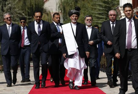 Afghanistan's new President Ashraf Ghani Ahmadzai (C) arrives for his inauguration as president in Kabul September 29, 2014. REUTERS/Omar Sobhani