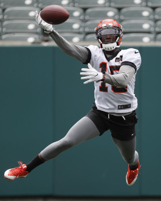 Cincinnati Bengals wide receiver John Ross reaches for a pass during practice at the NFL football team's training camp, Tuesday, June 12, 2018, in Cincinnati. (AP Photo/John Minchillo)