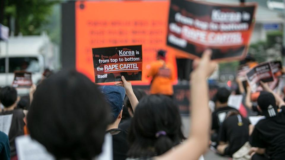 Feminists chant slogans as they hold signs that read, `Korea is from top to bottom the Rape Cartel itself`, during a rally on July 27, 2019 in Seoul, South Korea.