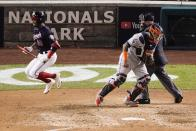 Washington Nationals' Victor Robles reacts after striking out during the seventh inning of Game 5 of the baseball World Series against the Houston Astros Sunday, Oct. 27, 2019, in Washington. (AP Photo/Alex Brandon)