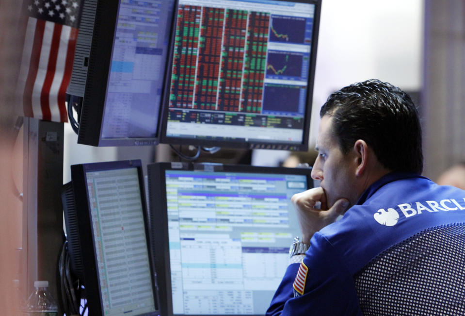 <p> In a Monday, May 7, 2012, photo, specialist Stephen D'Agostino works at his post on the floor of the New York Stock Exchange. Wall Street was headed for a lower opening Wednesday May 16, 2012, with Dow Jones industrial futures losing 0.1 percent and S&P 500 futures down 0.2 percent. (AP Photo/Richard Drew) </p>