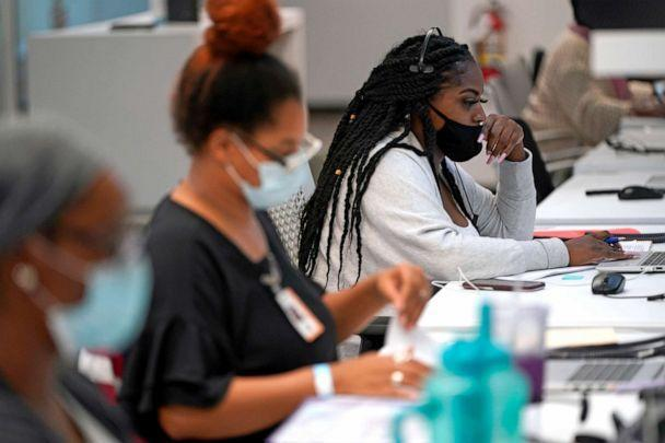PHOTO: Contact tracer Kandice Childress, right, works at Harris County Public Health contact tracing facility, June 25, 2020, in Houston. (David J. Phillip/AP)