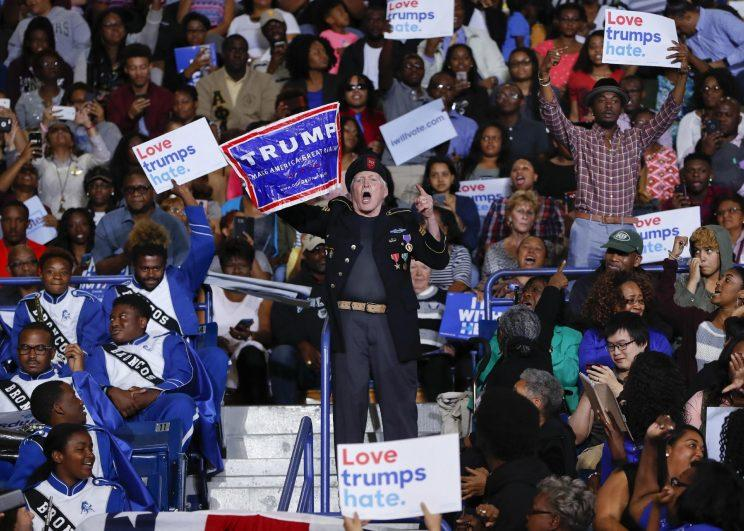 A supporter for Republican presidential candidate Donald Trump interrupts President Barack Obama's speech at Fayetteville State University, Friday, Nov. 4, 2016 in Fayetteville, N.C. (Photo: Pablo Martinez Monsivais/AP)