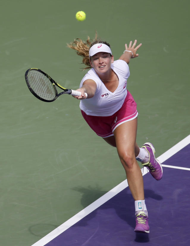 Coco Vandeweghe returns to Serena Williams at the Sony Open tennis tournament, Monday, March 24, 2014, in Key Biscayne, Fla. (AP Photo/Lynne Sladky)