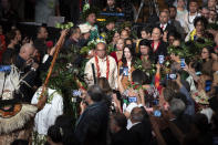 New Zealand Prime Minister Jacinda Ardern, center right, takes part in a ceremony in Auckland, Sunday, Aug. 1, 2021, to formally apologize for a racially charged part of the nation's history known as the Dawn Raids. The Dawn Raids are known as the time when the Pasifika people were targeted for deportation in the mid-1970s during aggressive home raids by authorities to find, convict and deport visa overstayers. (Brett Phibbs/New Zealand Herald via AP)