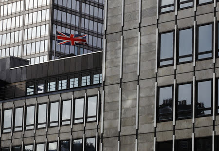 FILE PHOTO: The Union Flag is pictured on offices at the back of the Department of Business, Innovation and Sport in London October 21, 2013.     REUTERS/Luke MacGregor