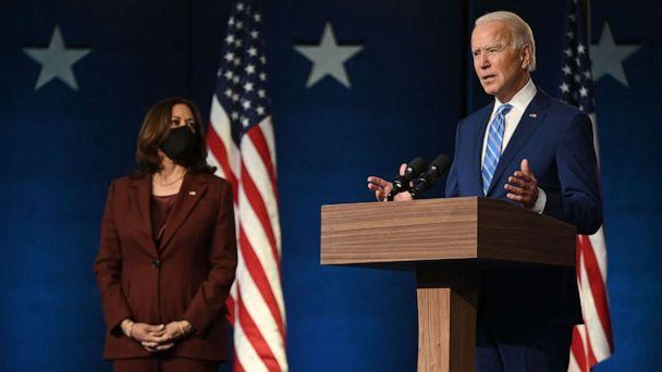 PHOTO: Democratic Presidential candidate Joe Biden speaks as Sen. and Vice-Presidential candidate, Kamala Harris, looks on at the Chase Center in Wilmington, Del., Nov. 4, 2020. (Jim Watson/AFP via Getty Images)