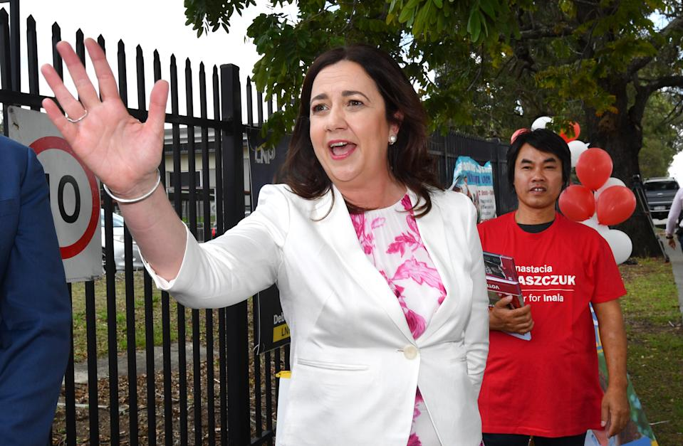 Annastacia Palaszczuk pointing in the direction of the volunteer who heckled her.