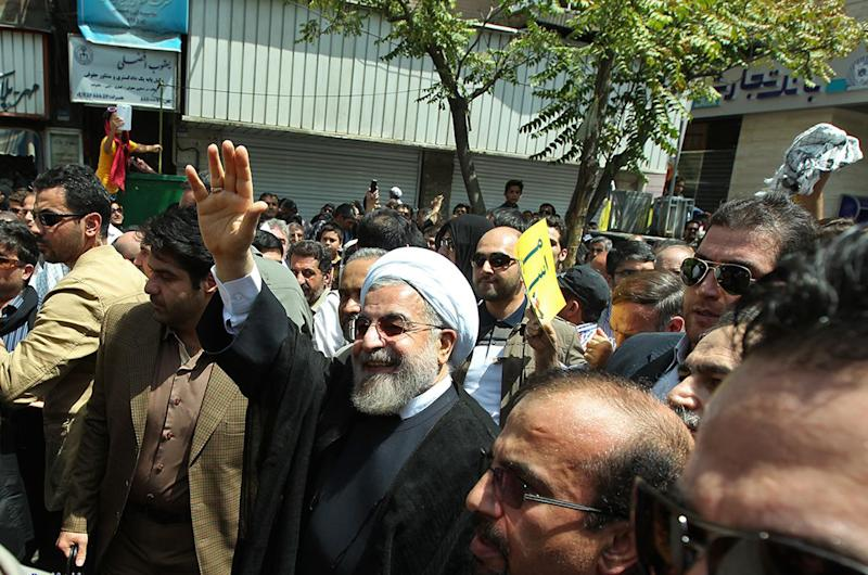 Iranian President Hassan Rouhani attends Quds Day demonstration in Tehran on July 25, 2014 (AFP Photo/-)