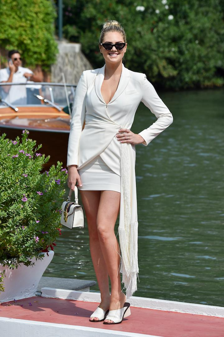 The model demonstrated how to sport tonal dressing in an all-cream ensemble finished with a pair of cat-eye sunglasses - the ultimate Hollywood touch. <em>[Photo: Getty]</em>