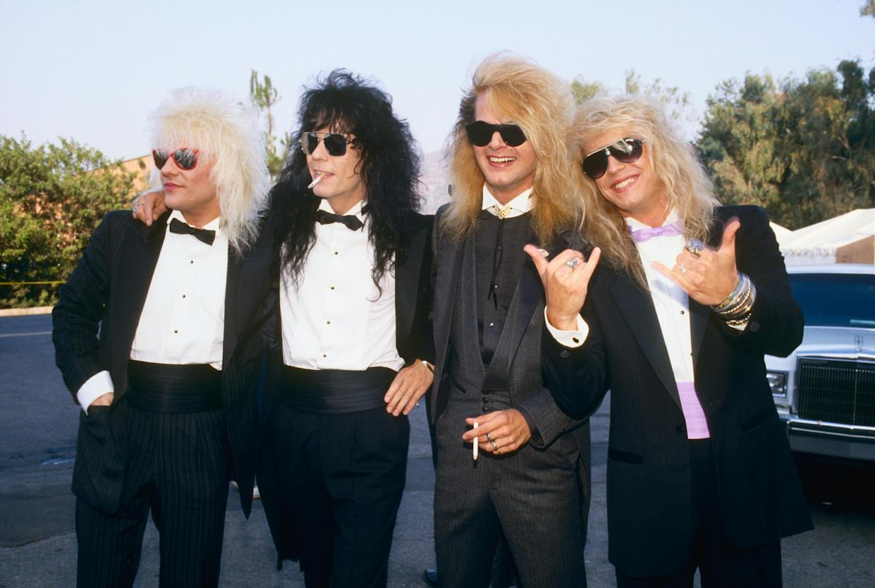Poison's C.C. DeVille, Bobby Dall, Rikki Rockett and Bret Michaels at the 1987 MTV Music Video Awards. (Photo: George Rose/Getty Images)