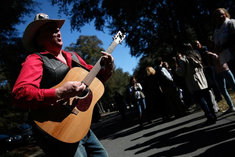 "Kraig Moss traveled from rally to rally with his guitar, crooning pro-Donald Trump tunes earning him the moniker ""the Trump troubadour"""