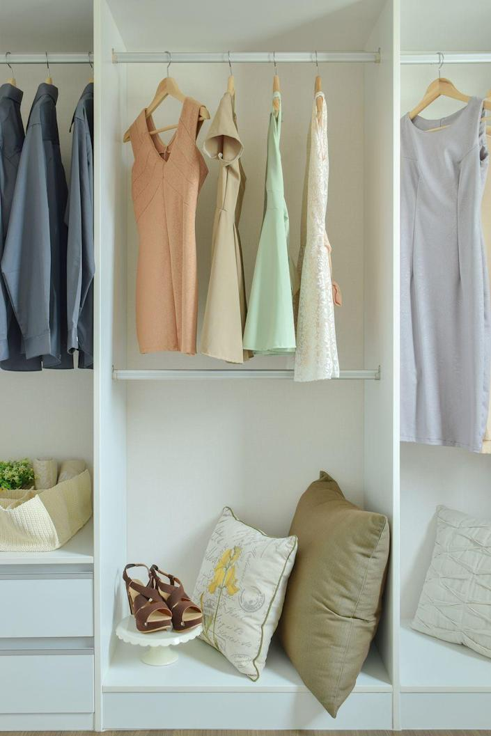 """<p>If your closet is smelling a little stale, you can freshen it up with some baking soda, according to The Spruce. Simply <a href=""""https://www.thespruce.com/using-baking-soda-to-freshen-closets-1900313"""" rel=""""nofollow noopener"""" target=""""_blank"""" data-ylk=""""slk:place an opened box of baking soda inside your closet"""" class=""""link rapid-noclick-resp"""">place an opened box of baking soda inside your closet</a>. Once there, it will absorb smells for up to a year — but make sure the box is in a spot where it won't spill!</p><p>Deodorizing your closet floor can also get rid of a musty closet smell. To deodorize the floor with baking soda, make a solution of one gallon of warm water, half a cup of vinegar, and a quarter cup of baking soda. Mop the floor with the solution, rinse with clean water, and dry thoroughly. </p>"""