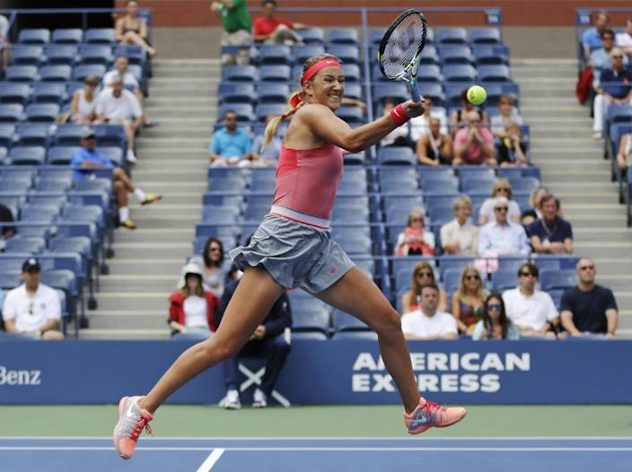 CORRECTS OPPONENT - Victoria Azarenka, of Belarus, returns a shot to Ana Ivanovic, of Serbia, during the quarterfinals of the U.S. Open tennis tournament, Tuesday, Sept. 3, 2013, in New York. (AP Photo/Julio Cortez)